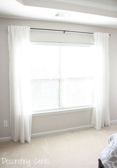 DIY Fabric Trimmed Curtains - This project has been on my list for a while and I can finally check it off.  We had plain white curtains from Ikea hanging in our…