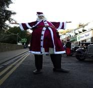 Christmas entertainers in London and the UK. Christmas stilt walkers for hire in the UK.