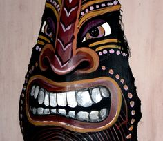 Tiki African palm frond mask