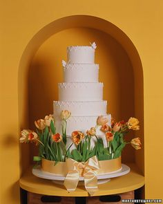 Sprouting Tulips Wedding Cake / i kinda like.... perfect for spring; add different details on the all-white cake though