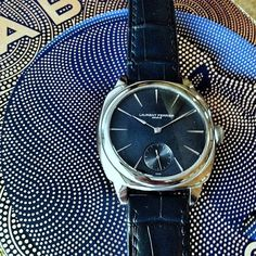 Beautiful blue dial of the Laurent Ferrier Galet Square on the blue mosaic