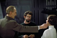 Peter Cushing, George Lucas, and Carrie Fisher on the set of Star Wars: A New Hope