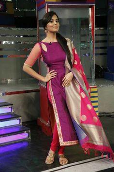 Telugu Anchor Anasuya Bharadwaj wearing a salwar suit by Designer Ashwini Reddy. A long length salwar matched with heavy Kanjivaram Dupatta. Long Dress Design, Dress Neck Designs, Designs For Dresses, Blouse Designs, Churidar Designs, Kurta Designs Women, Indian Designer Suits, Designer Salwar Suits, Indian Gowns Dresses