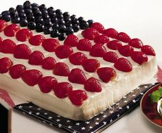 Angel-food Flag Cake. THIS IS THE ONE!!! I like just a sheet cake of angel food cake, then top with coolwhip, and finish it off with blueberries and strawberries on the top!! PERFECT!!!