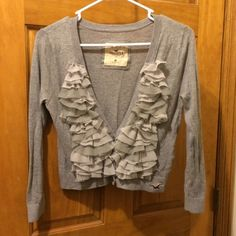 Gray Hollister Carsigan Super cute Hollister cardi with sweet chiffon ruffles! Cute over a t-shirt or dress. Normal wear, great condition!! Hollister Sweaters Cardigans