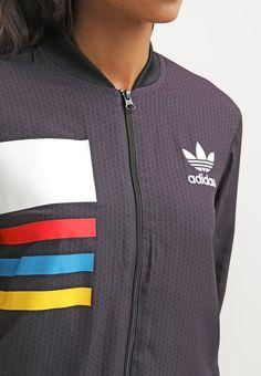 Diese Jacke ist ein echter Hingucker! adidas Originals Trainingsjacke - black…