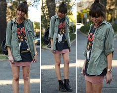 green army jacket, large band shirt, a fitted colored skirt, and combat boots