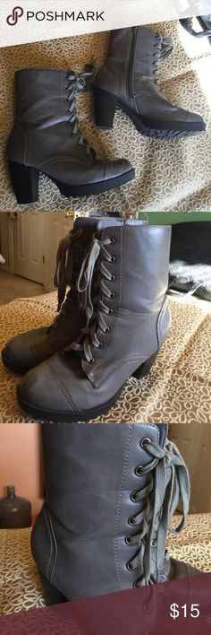 """Grey combat boots size 9 Grey faux leather with black bottoms. 3"""" heel with 1/2"""" platform. Laces in front and zipper on sides. Some signs of wear on bottom and heels but in good condition. Wet Seal Shoes Combat & Moto Boots"""