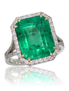 7 Emerald Engagement Rings ~ I love Emeralds plus it my birthstone. I'd love to have this bad boy