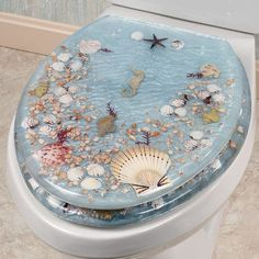Jewel Shell Elongated Toilet Seat is perfect for adding a touch of the beach to your bathroom. Decorative elongated toilet seat is made of layered resin. Nautical Bathrooms, Beach Bathrooms, Upstairs Bathrooms, Seashell Bathroom, Beach Theme Bathroom, Ocean Bathroom, Seashell Art, Coastal Homes, Luxury Houses
