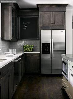 gray cabinets, gray backsplash, white countertops, dark floors. It works!!