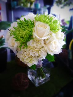 Green and white bride's bouquet with roses, spider mums and hydrangea.