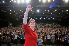 Confident leader: Nicola Sturgeon takes a selfie on stage following  her keynote speech at the SNP conference in Aberdeen last year. Picture: Getty
