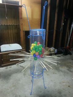 http://www.designdazzle.com/2013/06/make-a-giant-outdoor-kerplunk-game-from-tomato-cages/