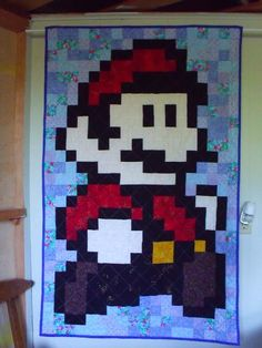 I said I would never do another quilt like this after making Link, but Mario is so cute and Joel would love it!