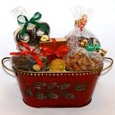 An amazing gift for anyone around the holiday season. This red collectable tin basket decorated with winter pinecones is filled with chocolate covered pretzels, foiled ornaments, chocolate dipped oreo's, connoisseur collection assortment pieces, nonpareils in milk and dark chocolate and much more!