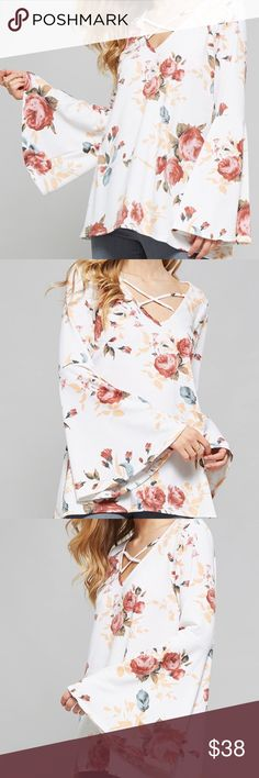 "Floral Bell Sleeve Top Floral Bell Sleeve Top  •Beautiful Floral print top  •Cutout detailed neckline •Wide bell sleeves •Made with medium weight fabric  •Soft, drapes well and stretches very well •Fabric: 96% rayon, 4% spandex  Approximate Measurements: •Small: Bust - 38"", Length - 27.5"" •Medium: Bust - 39"", Length - 28"" •Large: Bust - 41"", Length - 29""  Bundle 2+ items to receive 15% discount!   Ships same or next day from a Smoke-Free home! Tops Blouses"