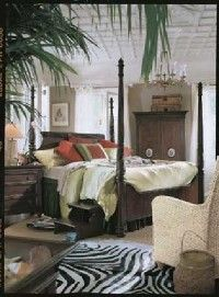 Dark Colonial-style furniture with white and bright green plants....Will do