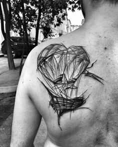 Polish tattoo artist Inez Janiak creates bold blackwork tattoos that look like charcoal sketches with imagery tinged with a hint of darkness.