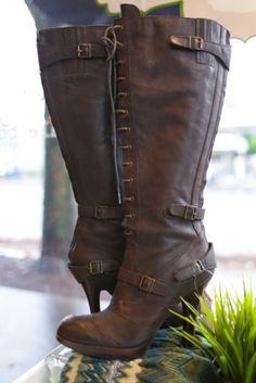 Brown heeled lace up boots