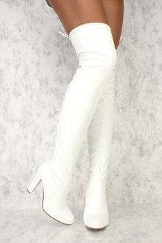 Stay in style with a pair of a AMI thigh high boots! These cuties are must have. Features include, a stretchy faux leather, distressed cut out, round toe, stitched trim, round toe, side zipper closure, thigh high with a banded tie, and a cushioned foot bed. Approximately a 4 inch heel, 20 1/2 inch shaft, and a 14 in circumference.