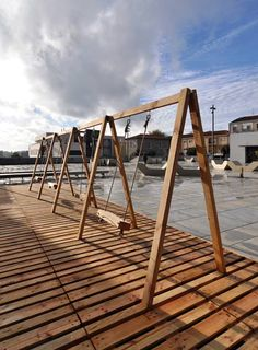 Playing on these swings outside an arts centre in Guimarães, Portugal, generates electricity to power lighting under the floor