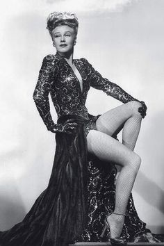 """This was one of the most expensive gowns ever made in Hollywood. The overskirt was mink, and the inner skirt was beaded using multicolored jewels. Because it was the 1940s, you had shoulder pads and gloves. The shoes kind of disappeared into the dress—which is important, because it was all about making Ginger Rogers' legs look longer. There was surely netting behind that deep V-neck so the dress would stay on her. This was before body tape."" Designed by Edith Head."