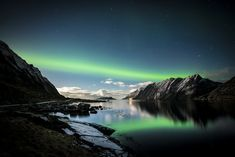 https://flic.kr/p/n44vr6 | p e r s i s t | lofoten, norway | ==> Find me on Instagram.  This particular streak of aurora light was already glowing rich green when we arrived in this spot.  Amazingly, while it had peaks and troughs of intensity, it remained intact and illuminated the entire four hours of our stay.  Thanks for looking.  -Lorenzo _________________________________________________  You can find more of my photos from Norway here.  My aurora borealis photos are all here.   Feel...
