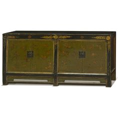 Hand Painted Tibetan Cabinet. Exuberant and bold, the artwork on this cabinet displays the liveliness of Tibetan art. Each door panel features an expressive hand-painted butterfly motif over a distressed dark green background. The doors are elegantly framed by a glossy black trim with gold floral accents. Tibetan furniture.
