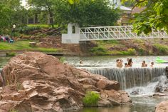 Plan a trip to Medicine Park in Oklahoma. It is a great summer destination near the Wichita Mountains Wildlife Refuge with beautiful swimming holes and charming shops.