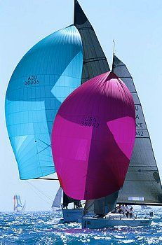 Sailboat with colorful sails.