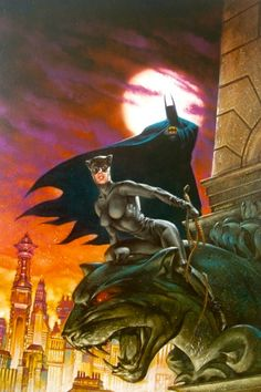 Batman and Catwoman survey the rooftops