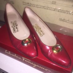 Vintage Ferragamo Pumps - size 7 1/2 AAA Vintage authentic Salvatore Ferragamo Pumps - size 7 1/2 AAA. Early 1990s. Gently worn on bottoms. Look new on tops and leather. Color is a maroon red. Box is included with the shoes.  Nice gold detail on front of shoes. Salvatore Ferragamo Shoes Heels