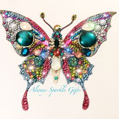 Hi, welcome to Always Sparkle Gifts This is my popular Butterfly Button Art mixed media art work. This butterfly is available to buy now. each tiny rhinestone is individually glued on by hand. I use quality glass rhinestones with a mix of Swarovski rhinestones for that added bit