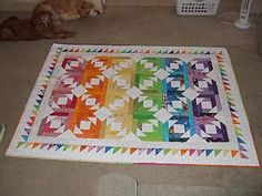 A rainbow Pineapple Blossom quilt