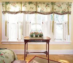 Casual Chic  Tie up a long window in style with this treatment. Long fabric ties are spaced down the length of fabric. Extra-long ties create interest all the way down to the pretty shutters.