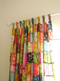 Use up all those scraps. Patchwork drapes.  LOVE!  Give a stained glass look with the light shining through