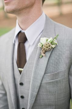 #boutonniere, #scabiosa-pod  Photography: Harwell Photography - harwellphotography.com Floral Design + Wedding Day Coordination: Everything and More Events - everythingandmoreevents.com