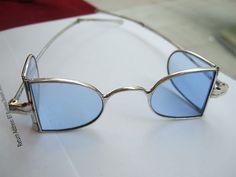 """Silver, Four lens """"D"""" shaped spectacles, light blue glass, """"C"""" bridge, turnpin temples"""