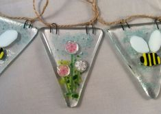 This fused glass bunting has been handmade by myself and fired in my kiln to 800 degrees then slowly cooled to ensure strength. Each bunting tile measures 7 cm by 6 cm and they are stung on string at 10 cm intervals. There are 6 bunting tiles in total and they alternate from bee to