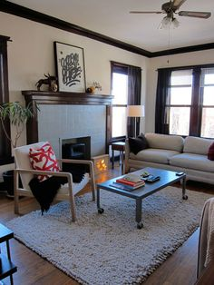 I love this living room.  So light and relaxing, and the dark brown accents are wonderful.