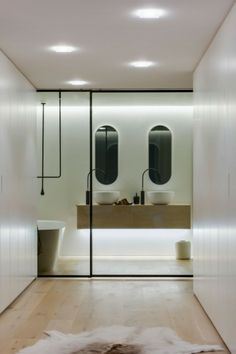 Elegant Modern Bathroom Designs With White Wall And Brown Cabinet And Double Up Mount Sink And Faucet With Small Mirror Frame And Subway Flo...