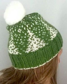 Free Knitting Pattern for Snowfall Hat - Slouchy beanie by Sara Setters features colorwork everygreens in the snow. Pictured project by Aussieraveler. Many Ravelrers have said the pattern knits up small so you may want to adjust.