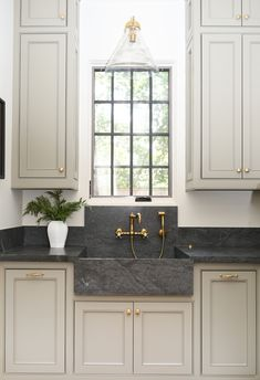 traditional kitchen design with soapstone counters and white kitchen cabinets iwht gold hardware, gold kitchen faucet in farmhouse kitchen design, white inset kitchen doors, cottage kitchen design, neutral kitchen with farmhouse sink Laundry Room Cabinets, New Kitchen Cabinets, Faucet Kitchen, Dark Cabinets, Cupboards, Kitchen Appliances, Bathroom Cabinets, Soapstone Counters, Kitchen Countertops