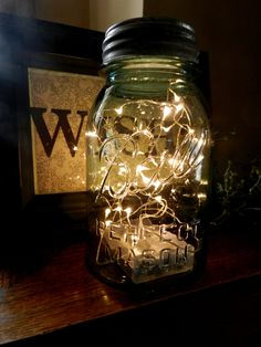 Fireflies in a Mason Jar/ LED Battery Operated Lighted Vintage Blue Mason Jar/Lights are Submersible. $20.00, via Etsy.