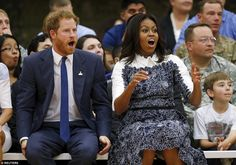 Prince Harry and US first lady Michelle Obama watch a game of basketball, played by wounded soldiers at Fort Belvoir, as part of an awareness event for the forthcoming 2016 Invictus Games to be played in Orlando, Florida