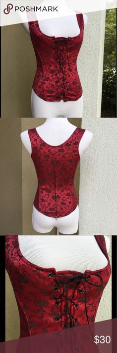 """VICTORIA'S SECRET Floral Corset Top Pretty in a burgundy/cranberry and black. Back zip. Front lace up over an attached stretch placket, with satin cord. Stretch satin with boning. Modeled by my size 6 mannequin, I feel this fits fairly TTS. Approx meas laid flat: U-U 4.5"""" across, waist 13"""" across, length side seam under arm 10."""", length shoulder seam to lowest front point of rounded 'dip' 20.5"""" (back is same). ⭐️ Looks amazing with jeans, and the Ariat Caldera boots in my other closet…"""