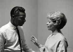 1960. Dinah Shore with guest Nat King Cole on the set of the Dinah Shore Chevy Show. From photos by Maurice Terrell and Robert Vose for a cover story on Dinah in the December 6, 1960, issue of Look magazine.