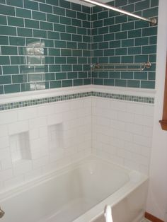 I like this combo approach to tiling the tub surround.
