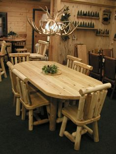 White Cedar Log Oval Dining Table and Chairs.  Who wouldn't love this for their log home.